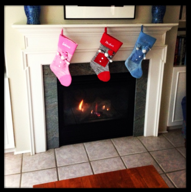 christmas stockings by fireplace with border